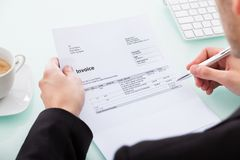 Businessman holding invoice Royalty Free Stock Photos