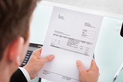 Businessman holding invoice paper Stock Image