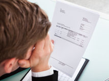 Businessman holding invoice paper Stock Photo