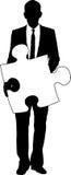 Businessman holding jigsaw stock photos