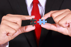 Businessman holding jigsaw Stock Photography
