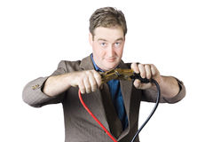 Businessman Holding Jumper Cables Stock Photos