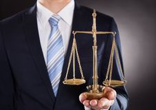 Businessman holding justice scale Royalty Free Stock Images
