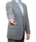 Businessman holding a key Royalty Free Stock Images