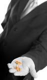 Businessman holding the key. Businessman holding the gold key. B/W royalty free stock image