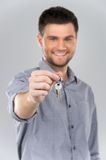 Businessman holding key with focus on key. Royalty Free Stock Photo