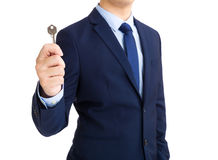 Businessman holding key in hand Royalty Free Stock Photos