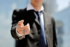 Businessman holding a key in his hand Stock Image