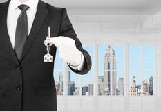 Businessman holding a key Royalty Free Stock Photo