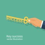 Businessman holding key of success. Businessman hand holding a key of success. Perspective development opportunities. Goals achievement. Business metaphor. Big Stock Photography