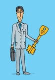 Businessman holding the key to success Royalty Free Stock Photos