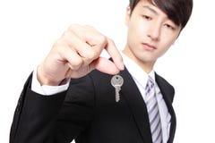 Businessman holding keys Stock Photo
