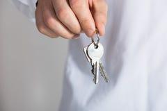 Businessman Holding Keys Royalty Free Stock Image
