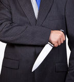 Businessman holding a knife Stock Photography