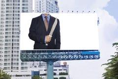 Businessman Holding knife on billboard Stock Photos