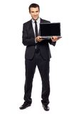 Businessman holding laptop Royalty Free Stock Photography