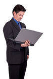 Businessman holding a laptop Stock Photo