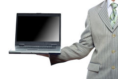 Businessman holding laptop Stock Images