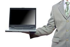 Businessman holding laptop Stock Images