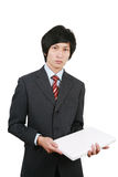 Businessman holding laptop Royalty Free Stock Photography