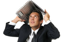 Businessman holding a laptop above his head Stock Photos