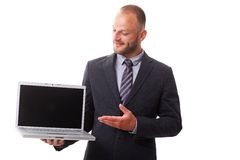 Businessman holding laptop with blank screen Stock Image