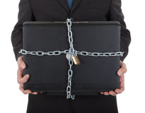 Businessman holding laptop with chain and lock Royalty Free Stock Photo