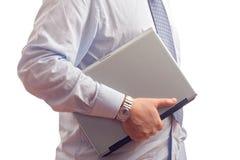 Businessman holding a laptop computer Stock Photos
