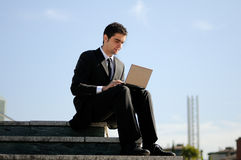Businessman holding a laptop computer Stock Photography