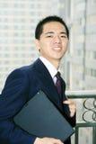 Businessman holding laptop computer Stock Image