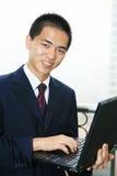 Businessman holding laptop computer Royalty Free Stock Image