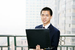 Businessman holding laptop computer Stock Image