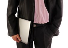 Businessman holding laptop- front view Stock Photo