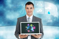 Businessman holding a laptop with graphics. Digital composite of business men holding laptop with apps Stock Photo