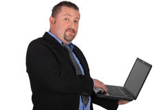 Businessman holding laptop Royalty Free Stock Images