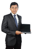 Businessman holding a Laptop. Indian Young Businessman holding a Laptop Royalty Free Stock Photography