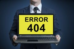 Businessman holding a laptop with a message error 404. Message error 404 royalty free stock photo