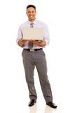 Businessman holding laptop Stock Photography