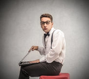 Businessman holding a laptop Stock Photography