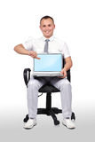 Businessman holding laptop Stock Image