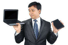 Businessman Holding Laptop and Tablet Royalty Free Stock Image