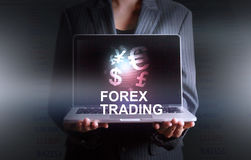 Businessman holding laptop world of currency forex trading. On background Stock Images