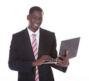 Businessman Holding Laptop Royalty Free Stock Photo
