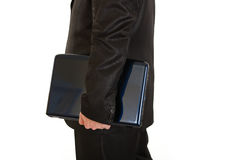 Businessman holding laptops in hand. Close-up. Stock Photos