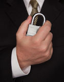 Businessman Holding Large Lock Royalty Free Stock Image
