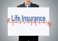 Businessman holding life insurance concept Royalty Free Stock Images