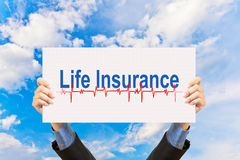 Businessman holding life insurance concept and blue sky Royalty Free Stock Photography