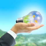 Businessman holding light bulb Stock Photography