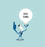 Businessman  holding light bulb in his hand ,get the big idea Stock Images