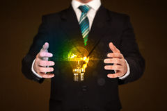 Businessman holding light bulb royalty free stock photo